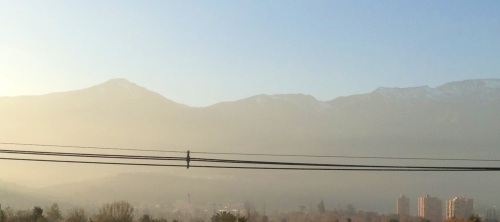 Here is the sun rising through the smog. That is not fog. See how the Andes have lost all their definition?