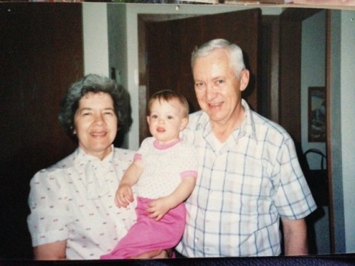 Twenty-seven years ago with my grandparents. Does Squeaker look like me?